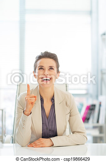 Happy business woman pointing on copy space - csp19866429