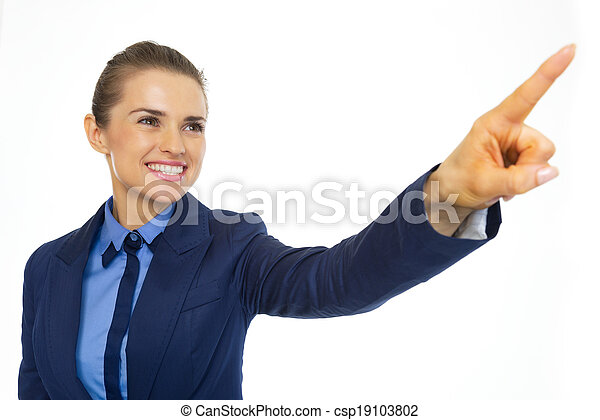 Happy business woman pointing on copy space - csp19103802