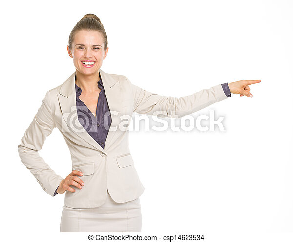 Happy business woman pointing on copy space - csp14623534