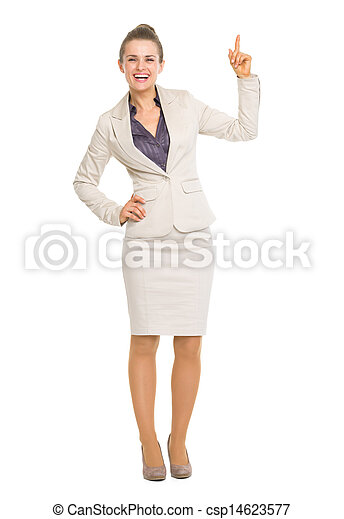 Happy business woman pointing up on copy space - csp14623577