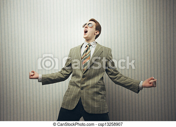 Happy businessman celebrating success with open arms - csp13258907