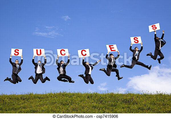 happy businessman holding success text  and jumping on the green field - csp7415906