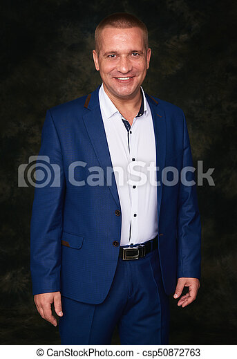 happy businessman over black background - csp50872763