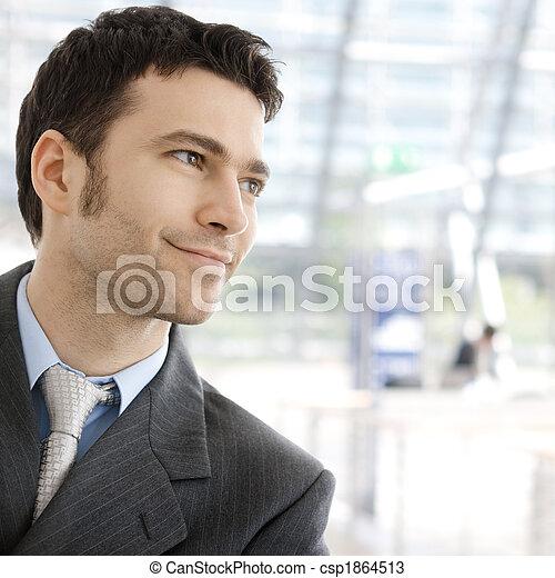 Happy businessman smiling - csp1864513