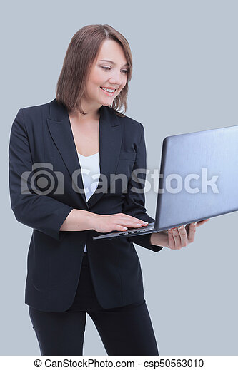 Happy business woman holding a laptop with copy space.
