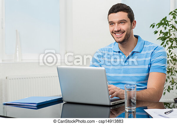 Happy businesswoman sitting at table with laptop - csp14913883