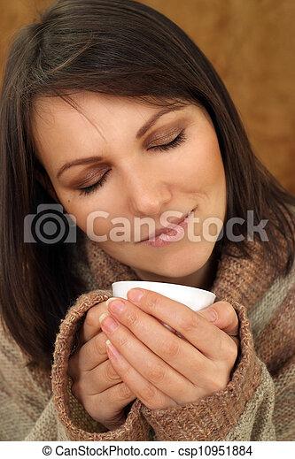 Happy Caucasian woman on a sofa - csp10951884