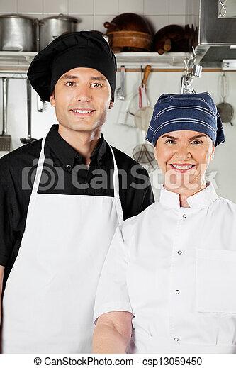 Happy Chefs In Industrial Kitchen - csp13059450