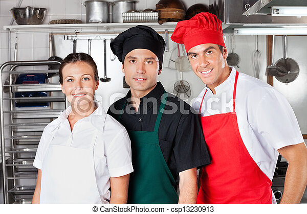 Happy Chefs In Kitchen - csp13230913