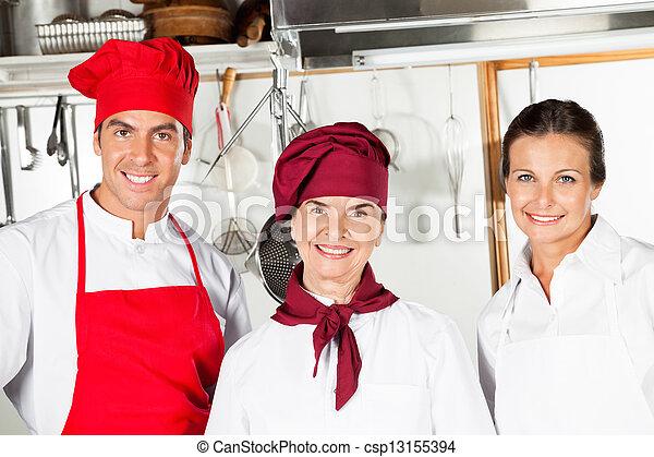 Happy Chefs In Kitchen - csp13155394