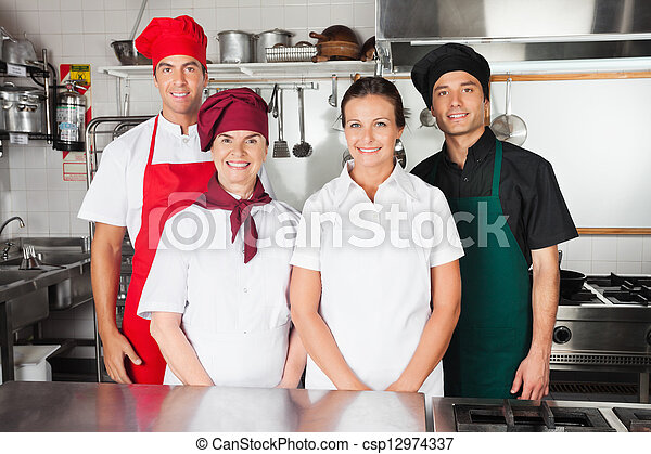 Happy Chefs In Kitchen - csp12974337