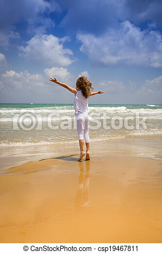 Happy child at the beach - csp19467811