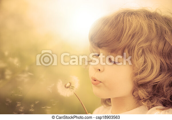 Happy child blowing dandelion - csp18903563