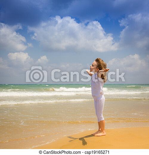 Happy child enjoying at the beach - csp19165271