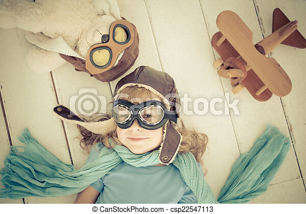 Happy child playing with toy airplane - csp22547113