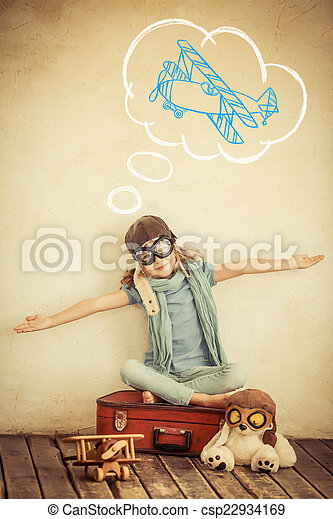 Happy child playing with toy airplane - csp22934169