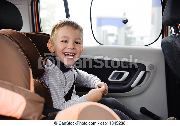 Happy child smiling in car seat - csp11345238
