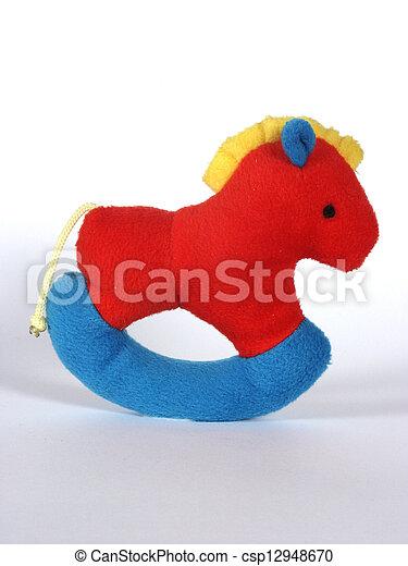 Happy childhood - swinging rattle - csp12948670