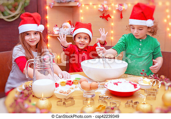 happy children making cookies csp42239349 - Making Christmas Cookies