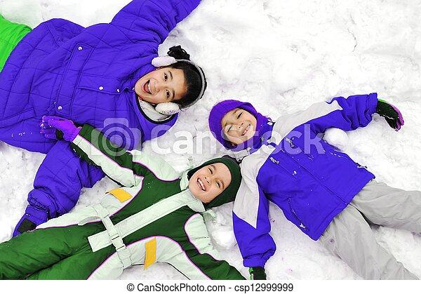 Happy children on snow - csp12999999