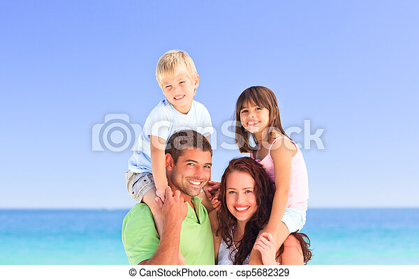 Happy children playing with their parents - csp5682329