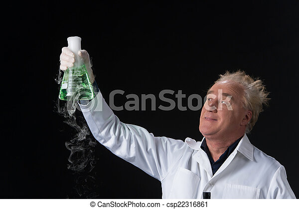 happy clinician studies in laboratory and holding flask aloft. man standing on black background and lifted flask - csp22316861
