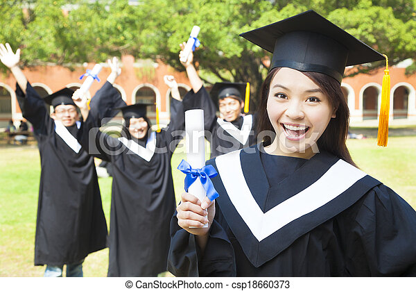 happy college graduate holding a diploma with friends - csp18660373