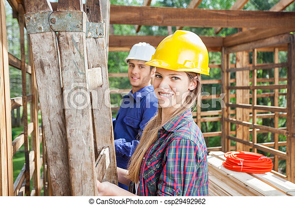 Happy Construction Worker With Colleague At Site - csp29492962