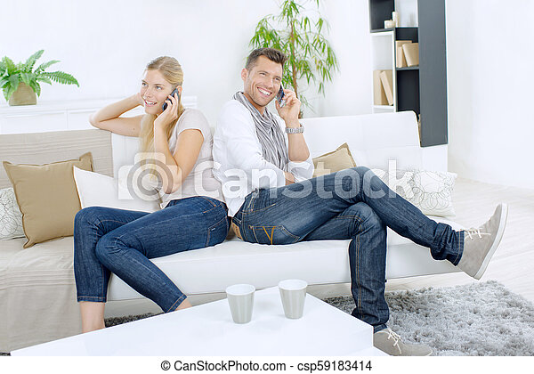Happy couple at home - csp59183414