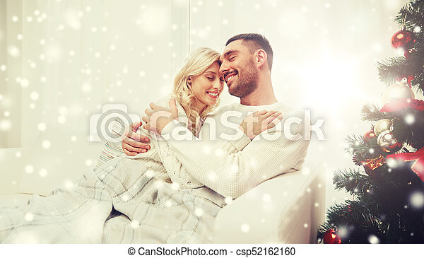 happy couple at home with christmas tree - csp52162160