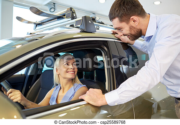 happy couple buying car in auto show or salon - csp25589768
