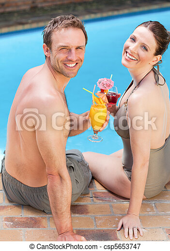 Happy couple drinking cocktails - csp5653747