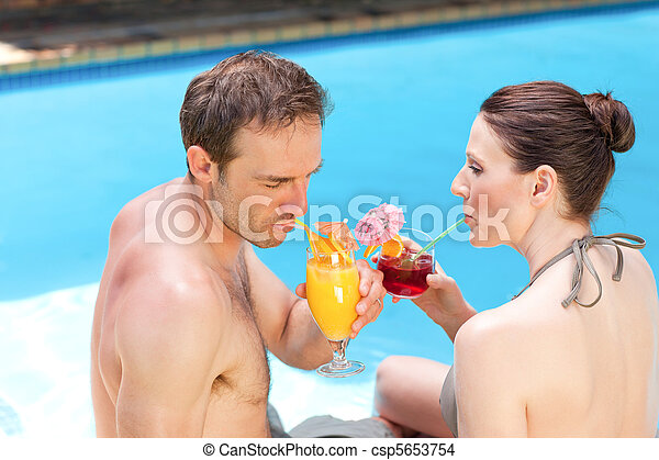 Happy couple drinking cocktails - csp5653754