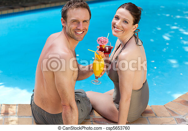 Happy couple drinking cocktails - csp5653760