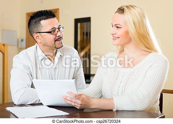 Happy couple filling in a questionnaire - csp26720324