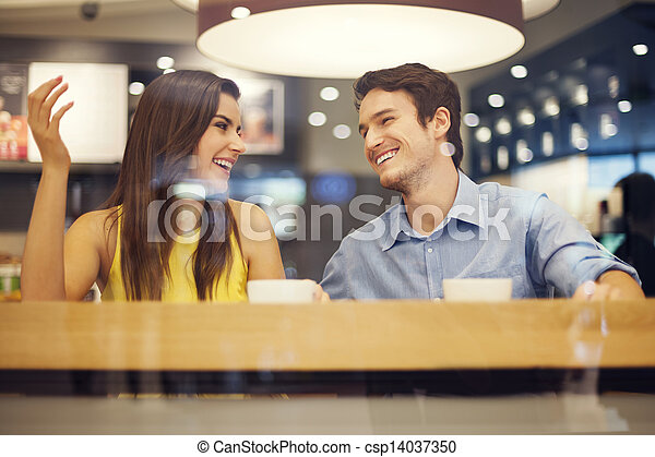 Happy couple have fun in cafe  - csp14037350