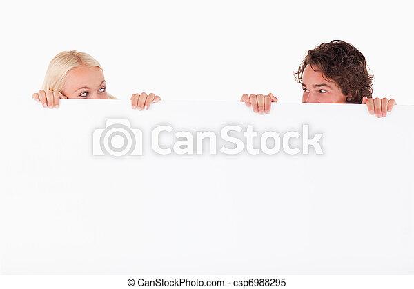 Happy couple hiding - csp6988295