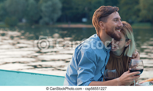 Happy couple in a boat - csp56551227