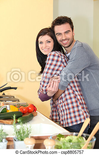happy couple in a kitchen - csp8805757