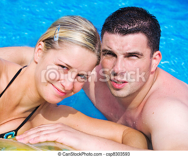 Happy couple in a pool - csp8303593