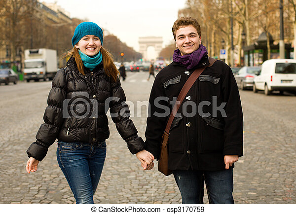 Happy couple in Paris on the Champs Elysees - csp3170759