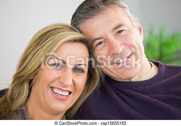 Happy couple looking at camera - csp15655183