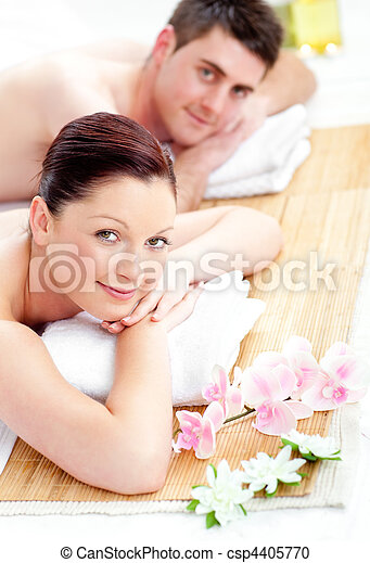 happy couple lying on a table - csp4405770