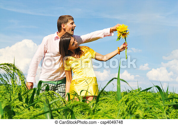 Happy couple on a lawn - csp4049748