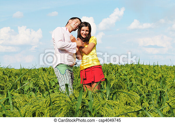 Happy couple on a lawn - csp4049745