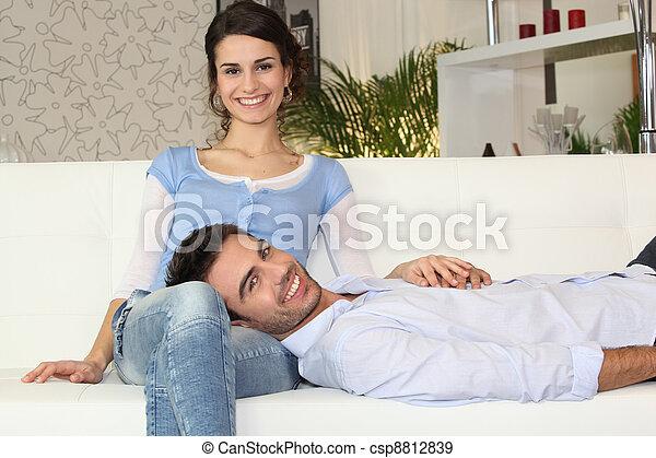 Happy couple on a sofa - csp8812839