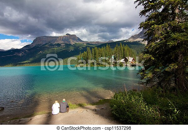Happy couple sitting on the shore of Emerald Lake in Yoho National Park - csp11537298