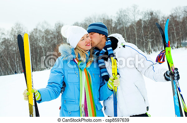 happy couple skiing - csp8597639