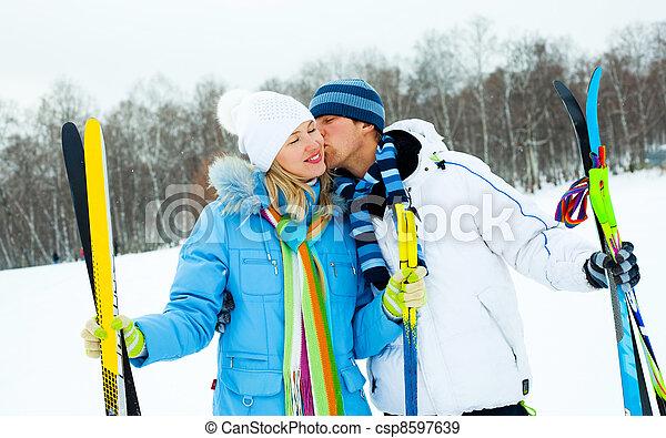happy couple skiing - csp8597639