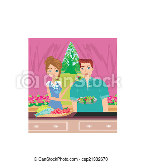 happy couple tests food in the kitchen - csp21332670